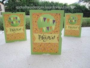 handmade card which hangs a pennant garland in a negative space window