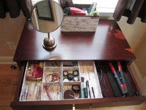 Vanity drawer containing makeup and hidden accessories