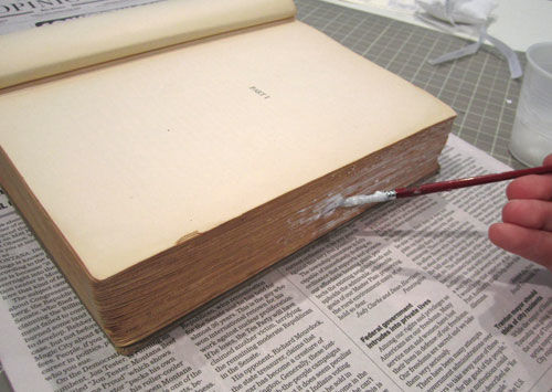 how to make a hollowed out book, first glue the edges