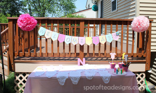 Welcome Baby Garland over Onesie Crafting Station | spotofteadesigns.com