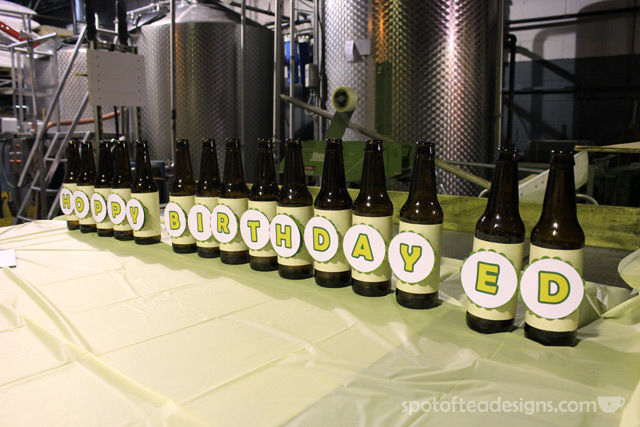 """Hoppy BIrthday"" decor using beer bottles for 60th birthday party held in a brewery 