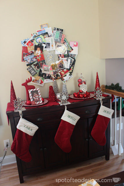 Christmas Card Wreath Display over red and silver decorations | spotofteadesigns.com