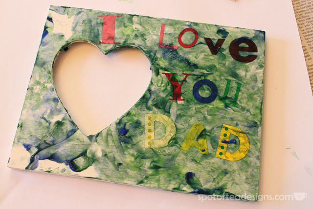 Father's Day Sticker Resist Frame: 9 month old baby project. Apply stickers, let them finger paint, then peel to reveal message! | spotofteadesigns
