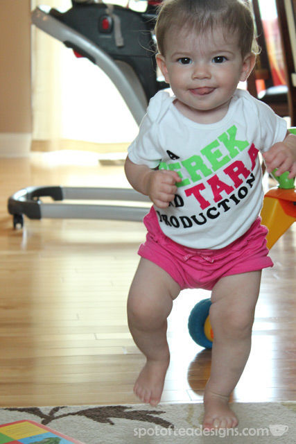 """DIY Onesie using iron on letters. Reads """"A Derek and Tara Production"""" 