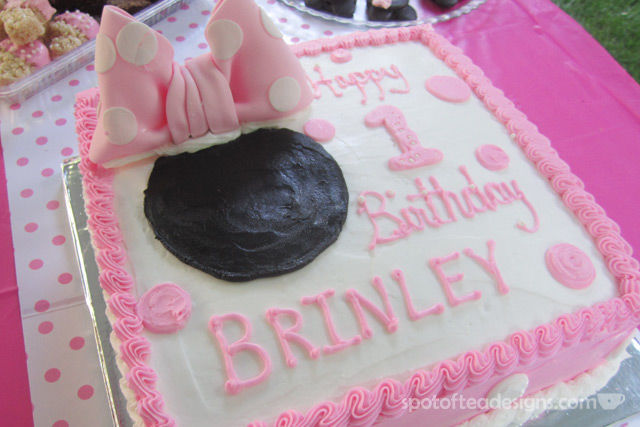 Minnie Mouse First Birthday Party: Cake with large fondant bow | spotofteadesigns.com