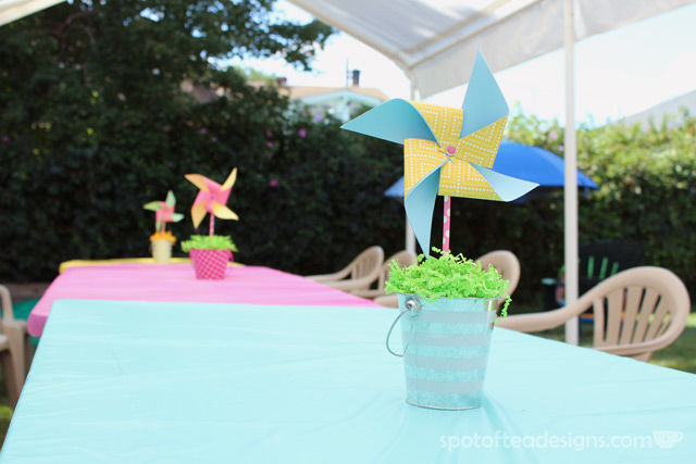 Pinwheel first birthday party: DIY Pinwheel Centerpieces with Pool Noodle as foam center. #birthdayparty | spotofteadesigns.com