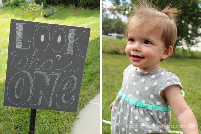 Pinwheel first birthday party: Look who's one faux chalkboard sign #birthdayparty | spotofteadesigns.com