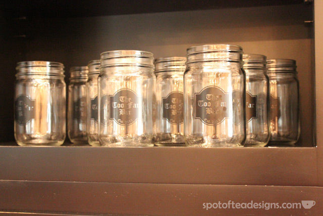 Beautiful Basement Bar Reveal: custom mason jars with bar's name #mancave | spotofteadesigns.com