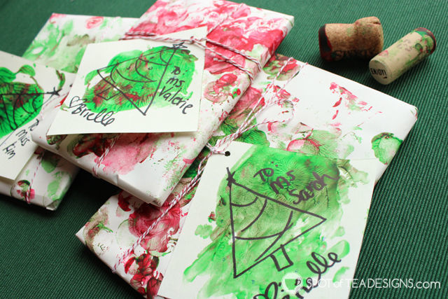 Gift wrap made by painting with corks. A fun kids craft that can be used to wrap teacher gifts! #kidscrafts #teachergift   spotofteadesigs.com