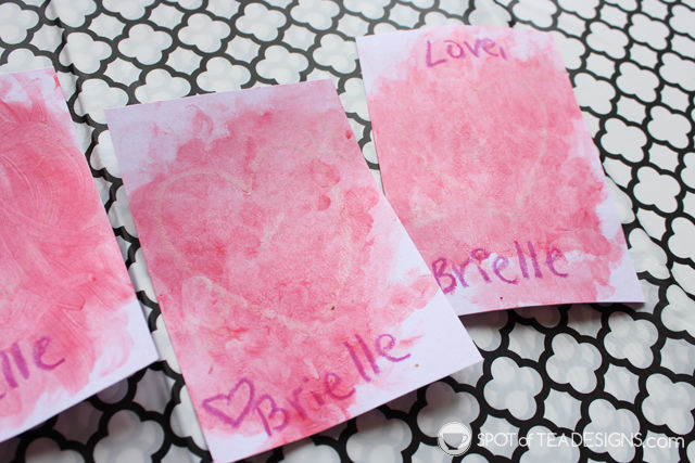 """Let kids perform """"magic"""" with this fun and easy crayon resist fingerpainted Valentine's craft using a white crayon. #kidscrafts #valentinesday 