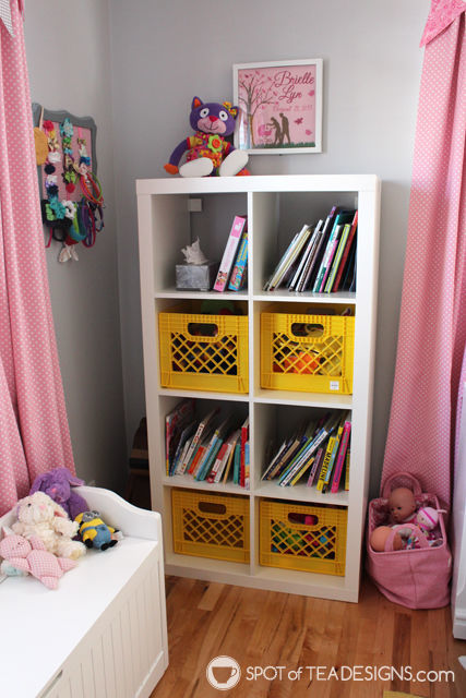 Pink and Yellow Toddler Bedroom Tour - colorful @landofnod milk crates in bookshelf | spotofteadesigns.com