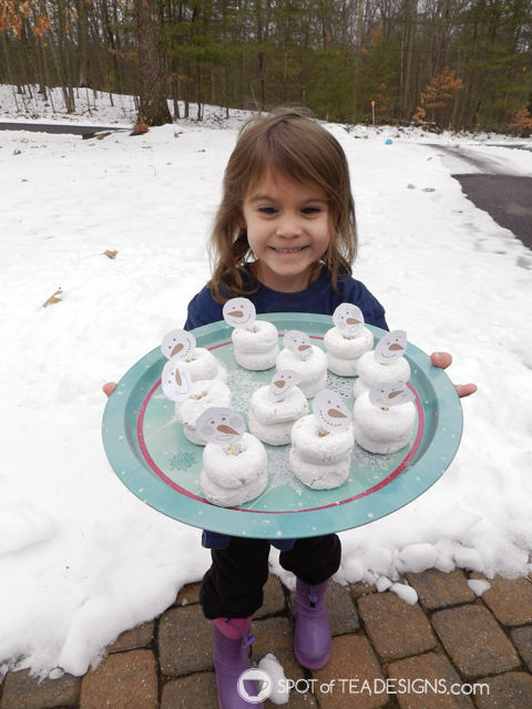 Snowman doughnuts created for winter birthday using free printables available at spotofteadesigns.com