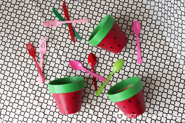Watermelon utensil pot - paint terra cotta pots for festive table decor for your summer party! | spotofteadesigns.com