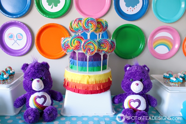 DIY rainbow lollipop holder - an easy way to display candy on your dessert table | spotofteadesigns.com