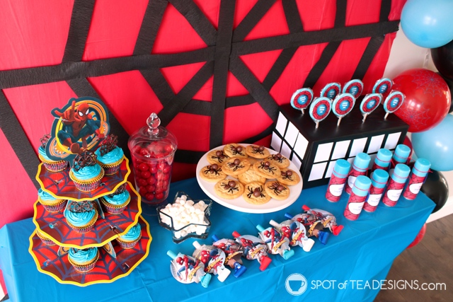 5+ budget friendly spider-man party hacks - lollipop stand is box wrapped in black tablecloth and white cardstock pieces | spotofteadesigns.com