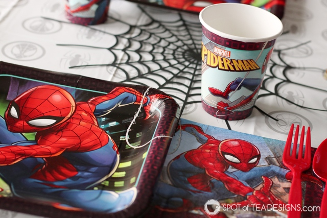 5+ budget friendly spider-man party hacks - diy table runner accent made with cricut cutting machine | spotofteadesigns.com